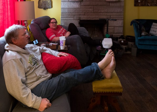 Ed and Tara Wunderlich spend the afternoon relaxing while watching movies Wednesday. The Wunderlichs received monoclonal antibody treatments intended to stop the progression of mild-to-moderate COVID-19 illness in patients at high risk. It is hoped the treatment will keep the illness from worsening and requiring hospitalization. Staff photo by MaCabe Brown